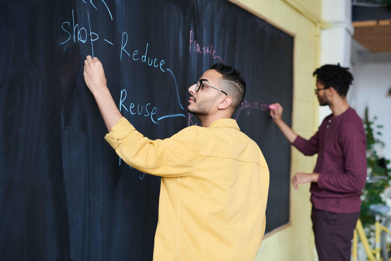 men-writing-on-board-3184645